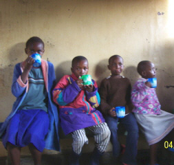 Orphans enjoying an afternoon cup of tea