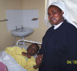 Sr. Lucy comforting a patient dying of AIDS