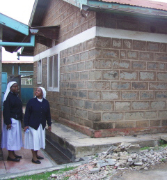 Sr. Christine and Sr. Lucy showing the outside of the new operating room