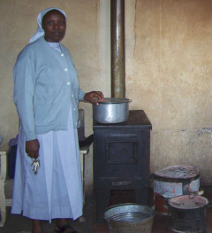 Sister Mary showing the stove that she uses to feed the children
