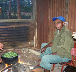 Cooking greens for the children over an open fire