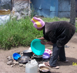 Jerusha washing dishes outside her home