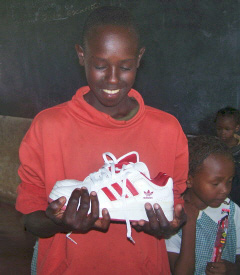 Gilson receiving his first pair of shoes